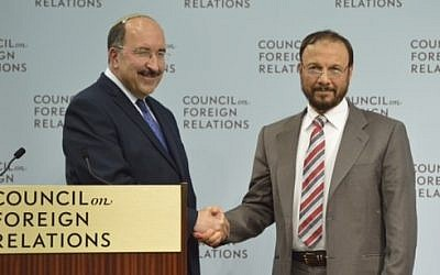 Israel's incoming Foreign Ministry Director-General Dore Gold and former Saudi government adviser Anwar Eshki shake hands in Washington DC, June 4, 2015 (Debby Communications Group)