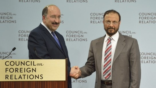 Israel's Foreign Ministry Director-General Dore Gold and former Saudi government adviser Anwar Eshki shake hands in Washington DC, June 4, 2015 (Debby Communications Group)
