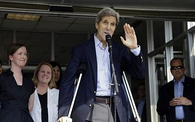 Secretary of State John Kerry waves after speaking to media as he is discharged from Massachusetts General Hospital Friday, June 12, 2015, in Boston. Kerry was released from the hospital after undergoing surgery on a broken leg sustained in a May 31 bicycle accident in France. (AP/Elise Amendola)