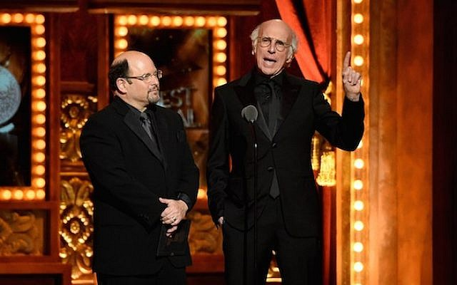 Jason Alexander, left, and Larry David speak onstage during the 2015 Tony Awards at Radio City Music Hall on June 7, 2015 in New York City.  (Photo by Theo Wargo/Getty Images for Tony Awards Productions/JTA)