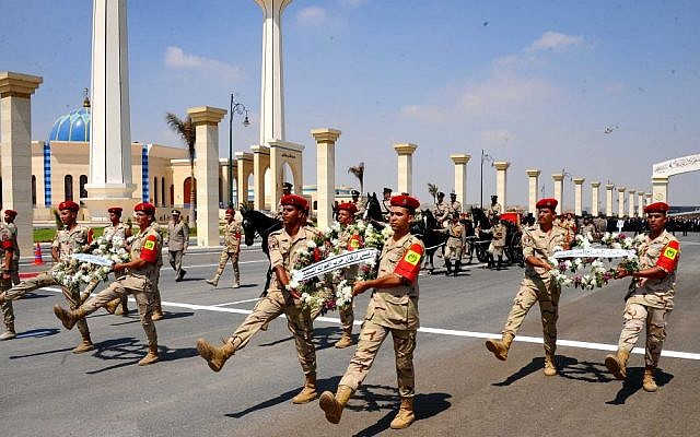 In this picture provided by the office of the Egyptian Presidency, a military procession accompanies the casket of Hisham Barakat, the top judicial official in charge of overseeing the prosecution of thousands of Islamists, including former President Mohammed Morsi, at his funeral in Cairo, Egypt, Tuesday, June 30, 2015. (Egyptian Presidency via AP)