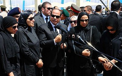 In this picture taken Tuesday, June 30, 2015, provided by the office of the Egyptian Presidency, Egyptian president Abdel-Fattah el-Sissi, center, speaks at the funeral for Hisham Barakat in Cairo. (Egyptian Presidency via AP)