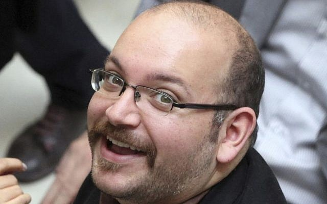 Jason Rezaian, an Iranian-American correspondent for The Washington Post, smiles as he attends a presidential campaign of President Hassan Rouhani in Tehran, Iran, April 11, 2013. (AP/Vahid Salemi, File)