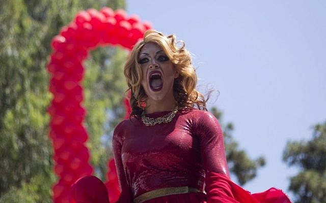 A drag queen sings during the annual Gay Pride Parade in Tel Aviv, Israel, Friday, June 12, 2015. (AP/Ariel Schalit)