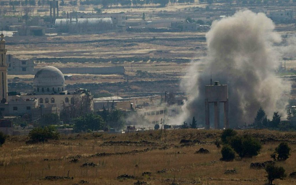 Smoke and explosions from fighting between forces loyal to Syrian President Bashar Assad and rebels, in the Quneitra area, seen from the Golan Heights, June 17, 2015. (AP/Ariel Schalit)