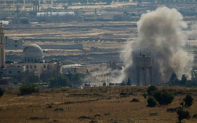 Smoke and explosions from fighting between forces loyal to Syrian President Bashar Assad and rebels, in the Quneitra area, seen from the Golan Heights, June 17, 2015. (AP/Ariel Schalit/ File)
