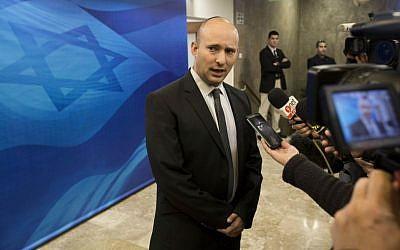 In this Jan. 18, 2015, file photo, Naftali Bennett speaks with the media ahead of a weekly cabinet meeting in Jerusalem. (Abir Sultan, Pool Photo via AP, File)