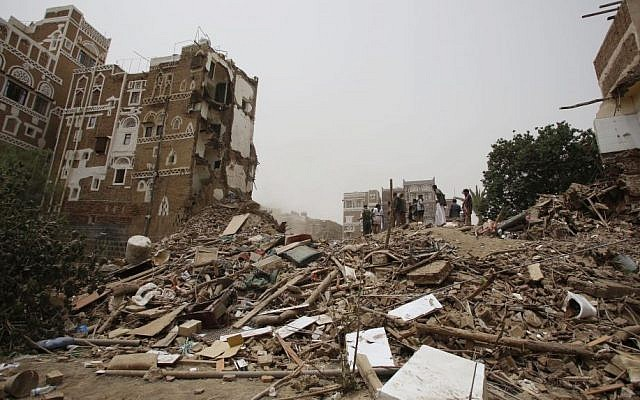 People search for survivors under the rubble of houses destroyed by Saudi airstrikes in the old city of Sana'a, Yemen, June 12, 2015. (AP/Hani Mohammed, File)