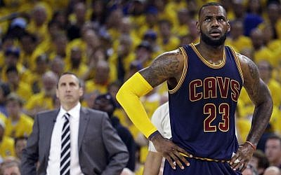 Illustrative: Cleveland Cavaliers forward LeBron James (23) stands on the court in front of head coach David Blatt during the first half of Game 2 of basketball's NBA Finals against the Golden State Warriors in Oakland, Calif., Sunday, June 7, 2015. (AP/Ben Margot)