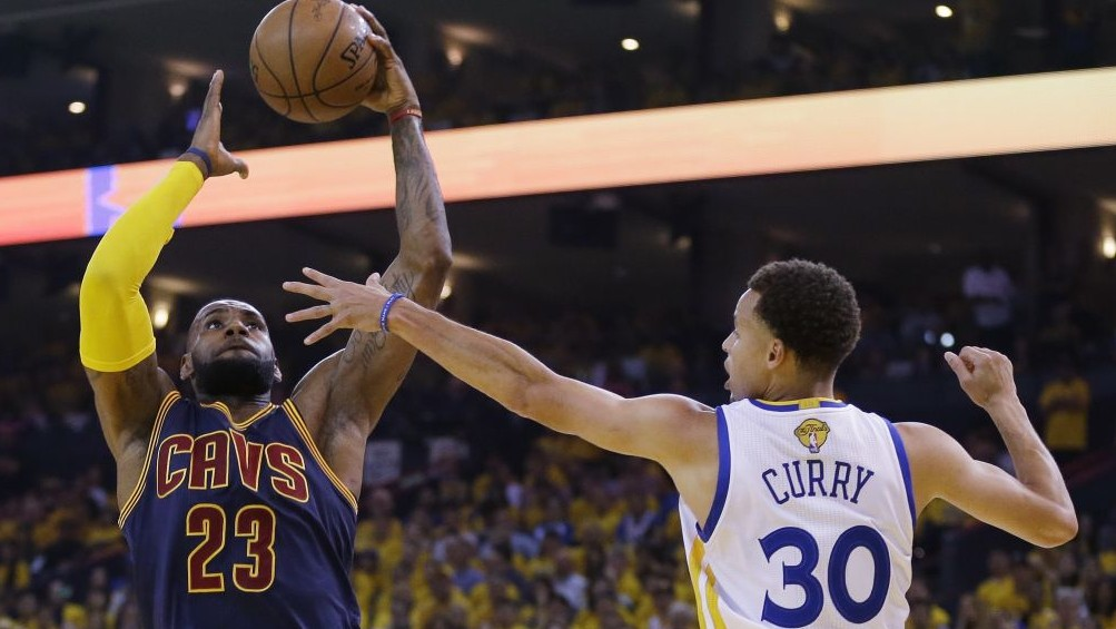 b785f8658794 Cleveland Cavaliers forward LeBron James (23) shoots against Golden State  Warriors guard Stephen Curry
