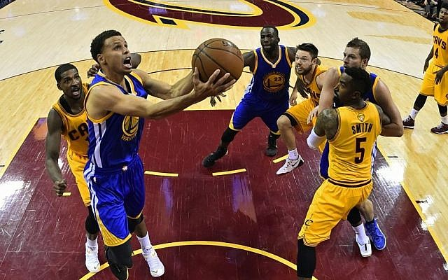 Golden State Warriors guard Stephen Curry (30) shoots in front of Cleveland Cavaliers center Tristan Thompson (13) during the second half of Game 3 of basketball's NBA Finals in Cleveland, Tuesday, June 9, 2015. The Cavaliers defeated the Warriors 96-91. (Larry W. Smith/Pool Photo via AP)