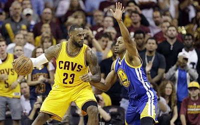 Cleveland Cavaliers forward LeBron James (23) drive son Golden State Warriors guard Andre Iguodala (9) during the second half of Game 3 of basketball's NBA Finals in Cleveland, Tuesday, June 9, 2015. (AP/Tony Dejak)