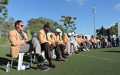 Pro Football Hall of Famers on a tour of Israel organized by New England Patriots owner Robert Kraft watch a scrimmage at Krafts Jerusalem stadium on June 21, 2015. (Ben Sales/JTA)