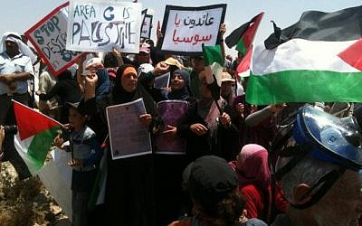Palestinian residents of Sussiya demonstrate against court ruling allowing the demolition of the village located in the southeast of Hebron on June 22, 2012. (Photo credit: CC BY-SA Mr. Kate, Wikimedia Commons)