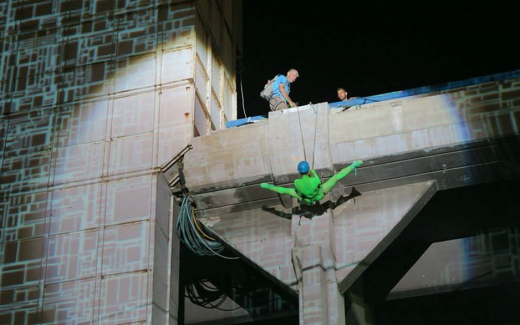 Rappelling down the side of Tel Aviv's Central Bus Station during White Night (Courtesy Brandon Berry)