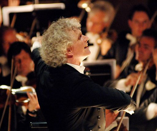 Sir Simon Rattle conducting the Berlin Philharmonic Orchestra in 2006 (Wikipedia)