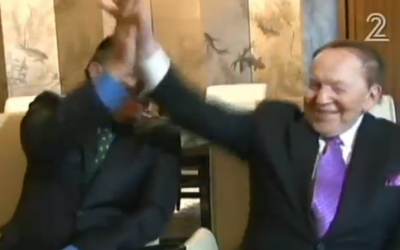 Haim Saban and Sheldon Adelson high five in a TV interview from Las Vegas, June 6, 2105 (Channel 2 screenshot)