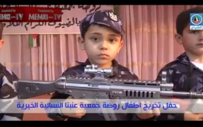 Palestinian pre-schoolers perform with toy guns at a West Bank kindergarten, June 2015. (MEMRI screenshot)