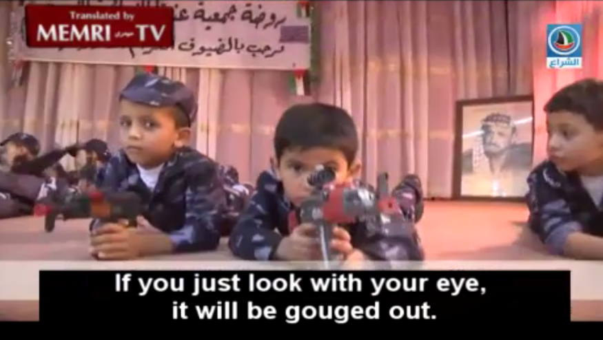Palestinian pre-schoolers perform with toy guns at a West Bank kindergarten, June 2015. A photograph of Yasser Arafat is at the back of the stage. (MEMRI screenshot)