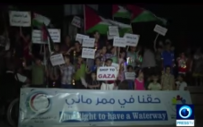 """Palestinian children at the Gaza port await the arrival of the third """"freedom flotilla"""" on Friday, June 26, 2015. (Screen grab: YouTube)"""