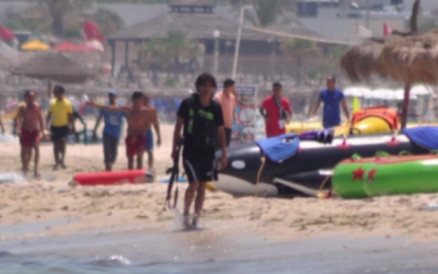 Seifedinne Rezgui, the gunman who allegedly murdered dozens in Tunisia, walking with his weapon on the beach after the massacre, June 26, 2015. (Sky News screenshot)