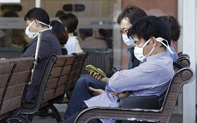South Koreans wearing masks as a precaution against the Middle East Respiratory Syndrome virus sit at an emergency room at Seoul National University Hospital in Seoul, South Korea Monday, June 1, 2015. (AP/Ahn Young-joon)