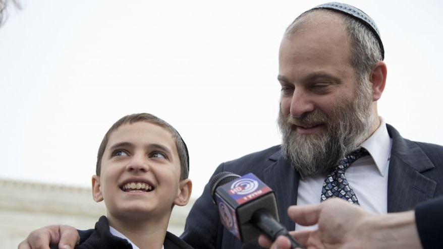 In this Nov. 3, 2014 file photo, Menachem Zivotofsky and his father Ari Zivotofsky speaks to media outside the Supreme Court in Washington. (AP Photo/Carolyn Kaster, File)