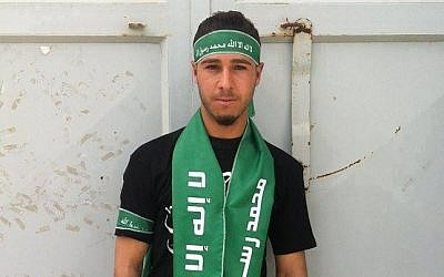 Jerusalem stabber Yasser Tarwa shown wearing Hamas scarf and headband (al-Resalah Facebook page)