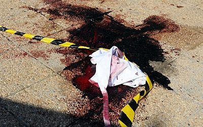 Blood and material on the ground near the area where a terror attack took place in Sousse, Tunisia, Friday June 26, 2015. (AP Photo/Hassene Dridi)