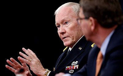 Joint Chiefs Chairman Gen. Martin Dempsey, left, accompanied by Defense Secretary Ash Carter, speaks during a news conference at the Pentagon, April 16, 2015 (AP Photo/Andrew Harnik, File)