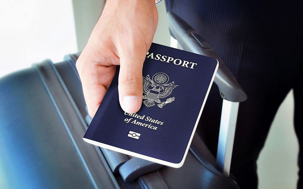 Illustrative: Man holding a US passport. (Shutterstock)