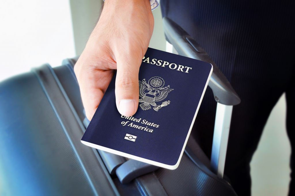 Illustrative Man holding a US passport