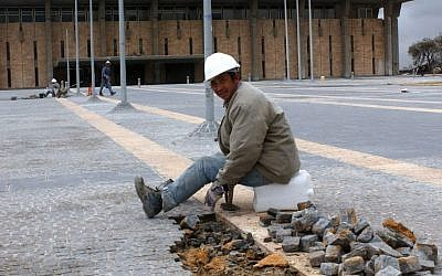 A Chinese construction worker sitting in front of the Knesset, the Israeli parliament building, January 08, 2004. (photo credit: Flash90)