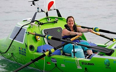 American rower Sonya Baumstein, from Orlando, Fla.,sets out in her custom rowboat for San Francisco Sunday, June 7, 2015. Baumstein, who hoped to be the first woman to row across the Pacific Ocean, had to give up her quest due to bad weather. (AP Photo/Shizuo Kambayashi)