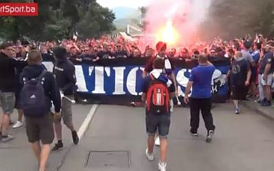 Bosnian soccer fans chant 'Palestine' at a protest in front of the hotel where players from the Israeli National Team were staying in Zenica, Bosnia, JUne 12, 2015, ahead of a Euro 2016 qualifier match between the two teams. (Screenshot)