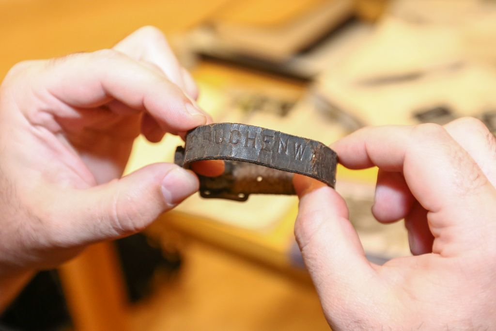 A prisoner's bracelet from the former Nazi concentration camp Buchenwald, in Germany, shown by Holocaust artifact collector Darrell English, founder of the New England Holocaust Institute & Museum (photo credit: Elan Kawesch/The Times of Israel)