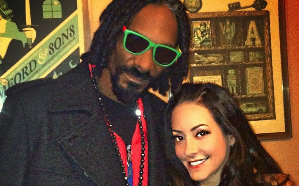 Dina Browner and the rapper formerly known as Snoop Dogg, who first introduced the Southern California native to marijuana. (Kevin Barkey/ via JTA)