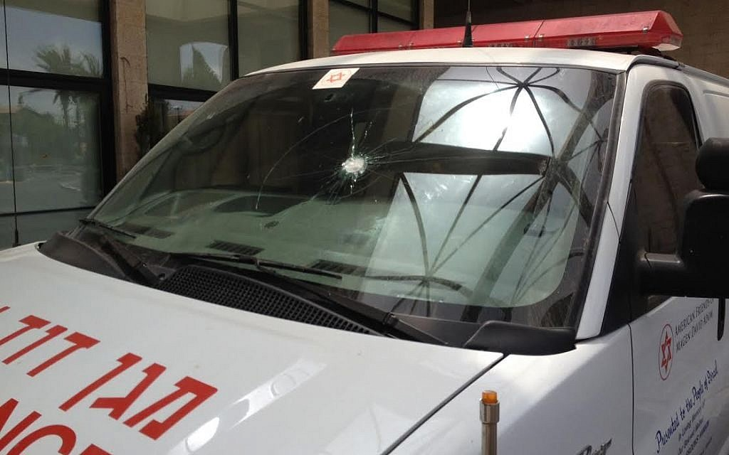 Bullet holes in a Magen David Adom ambulance, attacked in the West Bank on June 27, 2015 (Courtesy MDA)