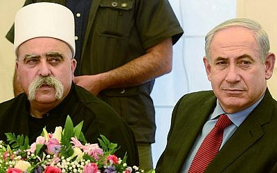 Prime Minister Benjamin Netanyahu meets with the spiritual leader of the Druze community in Israel, Sheikh Moafaq Tarif, in the village of Julis in northern Israel. April 25, 2013. (Moshe Milner/GPO)