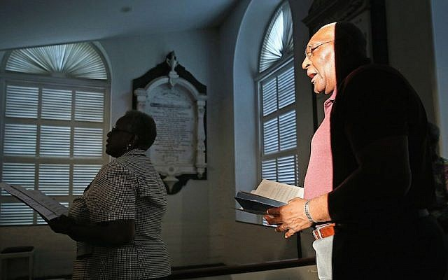 Mourners sing hymns during a community prayer service for the nine victims of last night's shooting at the historic Emanuel African Methodist Episcopal Church, at Second Presbyterian Church  June 18, 2015 in Charleston, South Carolina. (Chip Somodevilla/Getty Images via JTA)