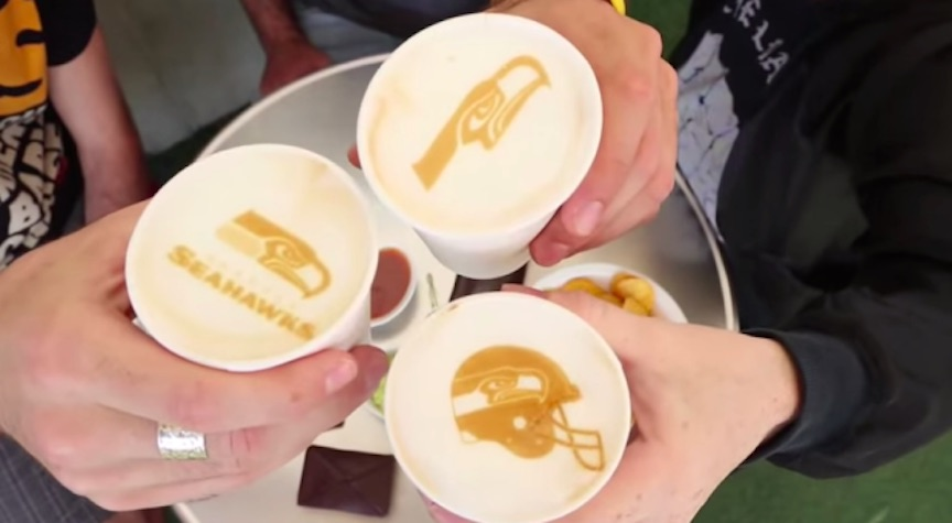 Football team logos printed onto cups of coffee by the Ripple Maker (Courtesy)