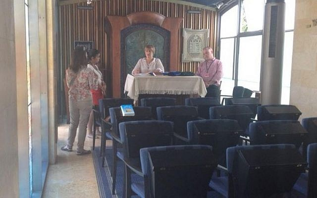 A photo from a May 26 planning meeting in the synagogue of the President's Residence, where a bar mitzvah ceremony for disabled children was to take place.  Left-to-right are Marianela Kreiman, coordinator of Masorti's bar/bat mitzvah program; a staffer from the Ministry for Diaspora Affairs; a member of the President's Residence staff; and Yizhar Hess, CEO of the Masorti movement in Israel.  (Photo by Ronen Ber-Avrahm.)