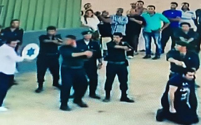 Syrian actor Bassem Yakhour, on his knees with a gun at his head, believes he is about to be executed by Israelis in this June 2015 Egyptian TV prank (Channel 2 screenshot)