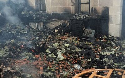 The aftermath of a suspected arson attack at the Church of the Multiplication at Tabgha on the Sea of Galilee on Thursday, June 18, 2015 (Fire and Rescue Services)