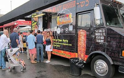 Thirty kosher food trucks and restaurants served up everything from falafel and shawarma to salads and cheese at the Celebrate Israel Parade in New Yorl, May 31, 2015. (Cathryn J. Prince)