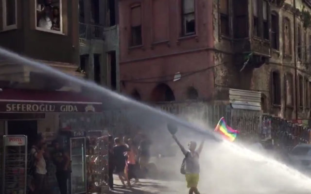 Turkish riot police use water cannon on a gay rights demonstrator during a Gay Pride parade, Istanbul, Turkey, June 28, 2015. (Twitter/David Lepeska)