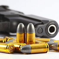 Illustrative image of a gun and bullets. (A gun and bullets via Shutterstock)