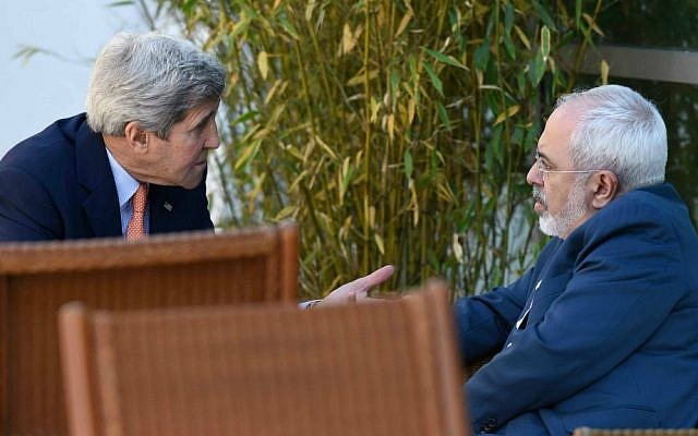 In this May 30, 2015, file photo, US Secretary of State John Kerry, left, talks with Iranian Foreign Minister Mohammad Javad Zarif, in Geneva, Switzerland, during negotiations on the future of the Iranian nuclear program. (AP Photo/Susan Walsh, Pool, File)