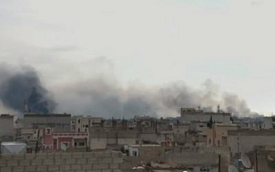 Smoke rises over the northern Syrian city of Kobani, on the Turkish border, during battles against Islamic State. (Screen capture: YouTube)