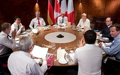 (Clockwise, from center) US President Barack Obama, Germany's Chancellor Angela Merkel, French President Francois Hollande, British Prime Minister David Cameron, Italy's Prime Minister Matteo Renzi, European Commission President Jean-Claude Juncker, European Council President Donald Tusk, Japan's Prime Minister Shinzo Abe and Canada's Prime Minister Stephen Harper attend a working dinner at a G7 summit at the Elmau Castle near Garmisch-Partenkirchen, southern Germany, on June 7, 2015 (AFP/POOL/STEPHEN CROWLEY)